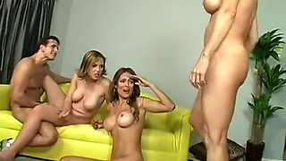 Three chicks unwrap their stud then strip for a dirty foursome