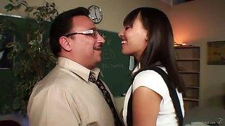 naughty brunette school girl having sex with her teacher in classroom