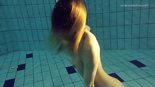 pretty girl with firm tits shows her hot body underwater