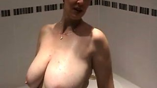 My short-haired wife loves playing with her big juicy tits in bathroom