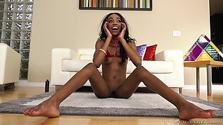Skinny flexible ebony teen babe Chanel Skye stretches out on the bed