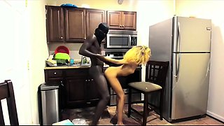 Slender ebony teen gets fucked by a dark stud in the kitchen