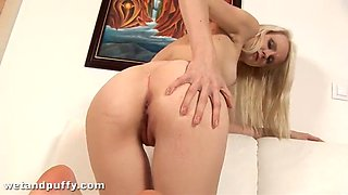blonde slut sticks a stick in her pussy