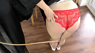 Mistress Granny Lacey canes her younger pupil