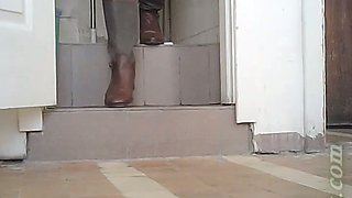 Pale skin blonde chick in boots pisses in the toilet