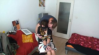 A tied up slut is being abused by an fellow