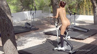 slender teenie does a sexy workout outdoors