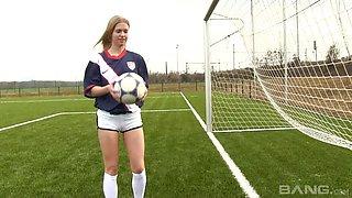 Soccer girl kicking a ball arnound and masturbating