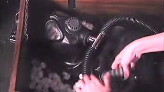Slave in latex gets all fixed up and her mistress stuffs her in a wooden box