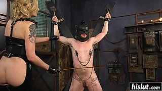 Tattooed mistress dominating her naughty slave