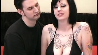 Seductive tattooed amateur with big natural tits in her first homemade porno flick