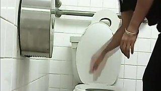 Woman pissing in public toilet