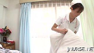 Oriental nurse deals extra big penis betwixt the lips