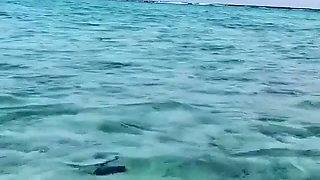 Salma Hayek in the water in a bikini