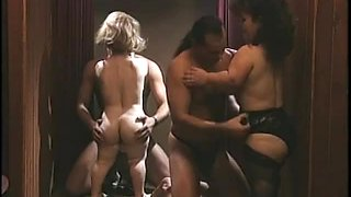 Midget sex in a group scene