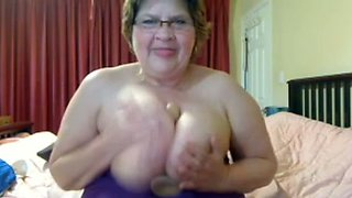 My horny old wife plays with her saggy boobs and masturbates with a dildo