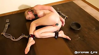 adorable blonde slave gets cuffed and plugged
