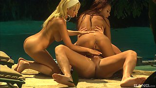 Carmen and Olivia are once again riding the dick next to the water