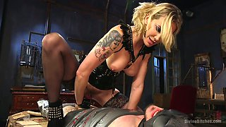 Angry mistress in latex corset punishes anal hole of one kinky tied up dude