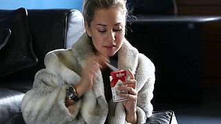 Smoking Fetish with hot blond and a fur coat