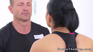 Beautiful fit brunette bangs her coach in gym