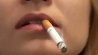 Pretty girl smoking very close-up lips and nails