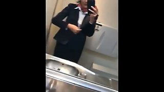 Naughty stewardess with hot tits masturbates in toilet