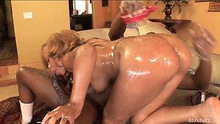 Nice ass ebony pornstar oils her hot body before riding a big black cock hardcore