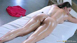Oiled slut with massive tits gets her pretty face creamed