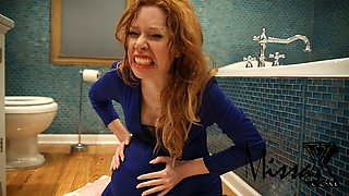 redhead woman gets freaky in the bathroom solo
