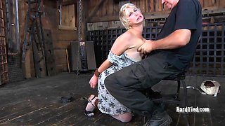 Blonde sex slave treated to her master's erected boner