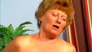 Busty and lascivious gilf in her bedroom sucks dick of a young man