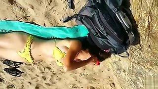 Cumming to a sleeping bikini girl on the beach