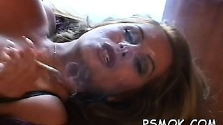 Hottie smoking while giving a oral-stimulation to her man