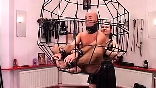 Caged slave getting humiliated by his merciless Mistress