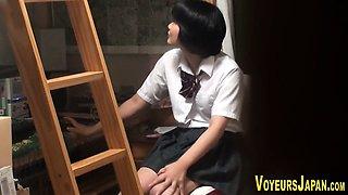 Japanese student rubs box