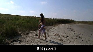 Busty teen gets laid with oldman on the beach