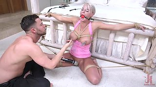 ball-gagged blonde getting punished in the bedroom