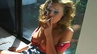 Hot babe is smoking a nice cigarette