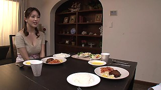 Busty Japanese housewife gives an erotic titjob and blowjob
