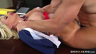 Blonde slut wearing college uniform blows and gets fucked in an office