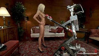 busty blonde has a great time fucking with machines