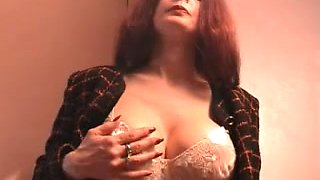 Long red haired slutty nympho in nylon pantyhose rubs her own clit