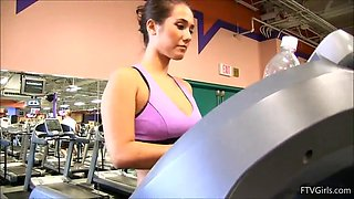 hot babe shows her boob while she's in the gym