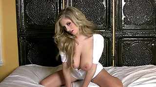Jenny McClain spreads on the bed