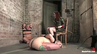 redhead dominatrix playing with guy and blonde in bdsm femdom vid