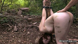 Clothed dude fucks face and bare ass of tied up sex slave outdoor