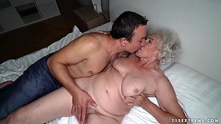Granny Norma cheats on her sleeping husband with young stud