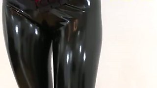 This smoking hot gal is dancing for me in her sexy latex leggings