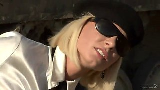 short haired blonde in glasses sucks then rides a big cock outdoors